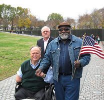 Vietnam Veterans Paul Middleton and Max Cleland shaking hands at the Vietnam Veterans Memorial, aka The Wall.
