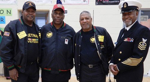 Four Veterans from Black support group pose standing together