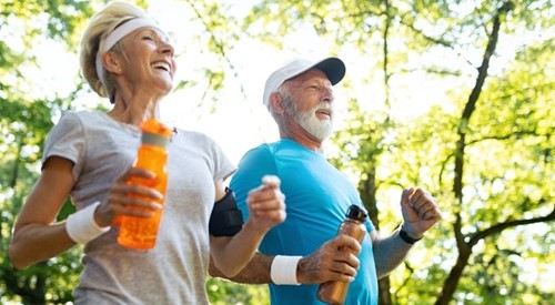 Older couple, man and woman, running together