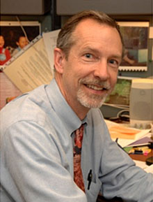 Photo of Dr. Sayers in his office.