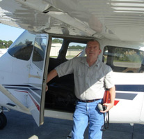 Vietnam Veteran Steven Kraus standing next to an airplane, ready for his flying lesson.