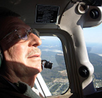 Vietnam Veteran Steven Kraus flying an airplane.